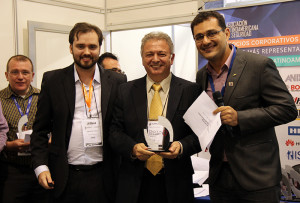 VP Group directors present the awards to Bonilha (center)